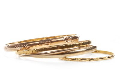 Lot 71-FIVE GOLD BANGLES
