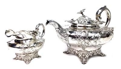 Lot 925 - A VICTORIAN SILVER TEA POT AND CREAM JUG