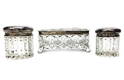 Lot 914 - A LOT OF THREE SILVER TOPPED DRESSING TABLE JARS