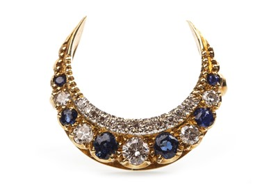 Lot 1-A DIAMOND AND BLUE GEM SET CRESCENT BROOCH