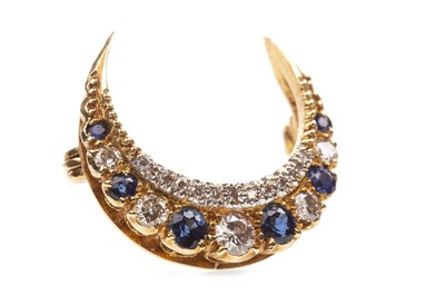 Lot 1-A DIAMOND AND BLUE GEM SET CRESCENT BROOCH