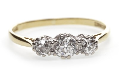 Lot 26-A DIAMOND THREE STONE RING