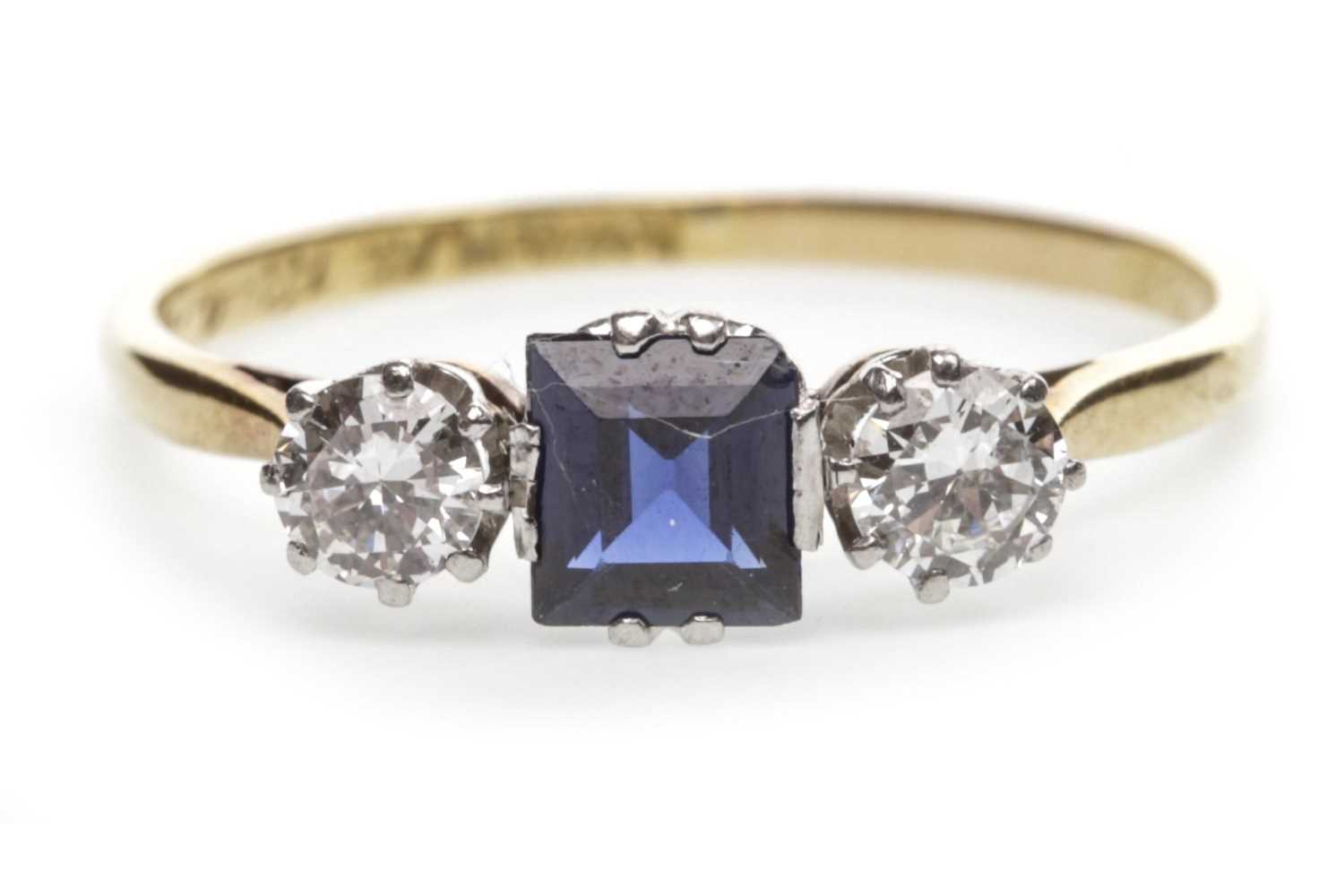 Lot 27-A BLUE GEM SET AND DIAMOND THREE STONE RING