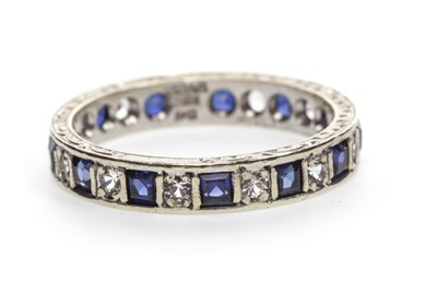 Lot 29-A BLUE AND WHITE GEM SET BAND
