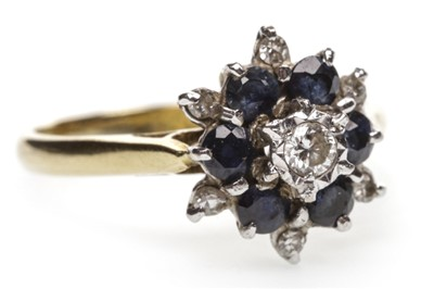 Lot 46-A BLUE GEM SET AND DIAMOND CLUSTER RING