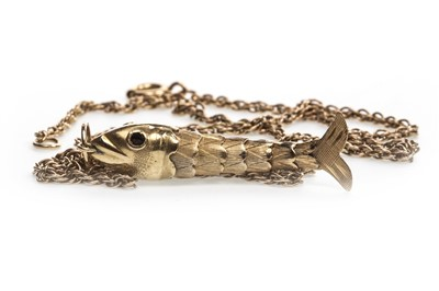 Lot 51-AN ARTICULATED FISH PENDANT