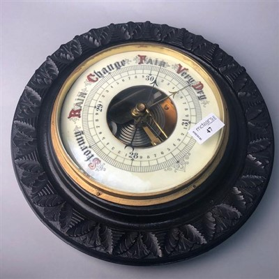 Lot 47-A CIRCULAR STAINED WOOD WALL BAROMETER