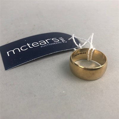 Lot 12-A NINE CARAT GOLD WEDDING BAND
