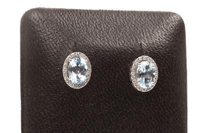 Lot 68-A PAIR OF BLUE TOPAZ AND DIAMOND EARRINGS