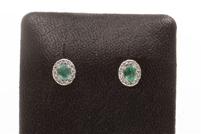 Lot 77-A PAIR OF EMERALD AND DIAMOND EARRINGS