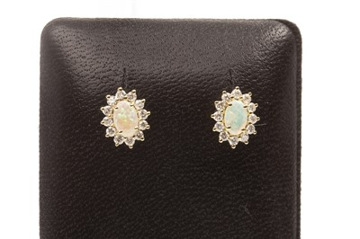 Lot 80-A PAIR OF OPAL AND DIAMOND EARRINGS