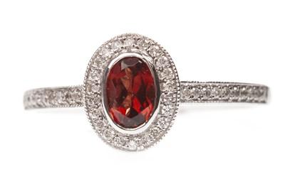 Lot 82-A GARNET AND DIAMOND RING