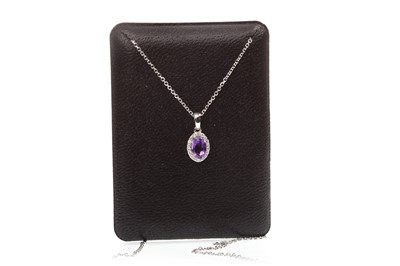 Lot 97-AN AMETHYST AND DIAMOND PENDANT