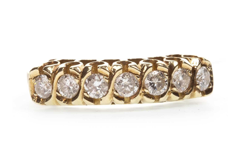Lot 119-A DIAMOND SEVEN STONE RING