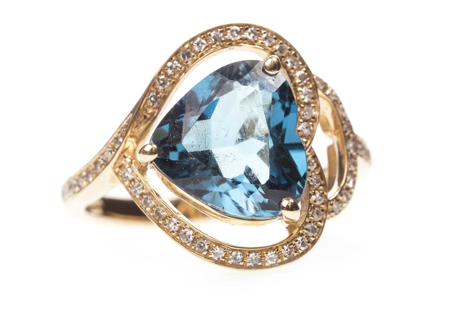 Lot 141-A TOPAZ AND DIAMOND RING