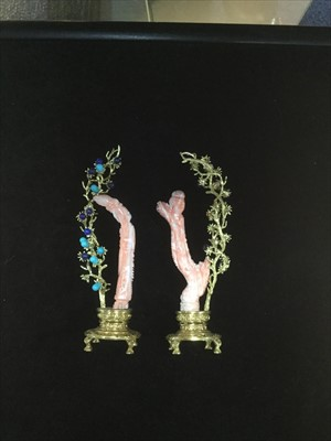Lot 1031-A PAIR OF CHINESE CORAL CARVINGS OF FEMALES