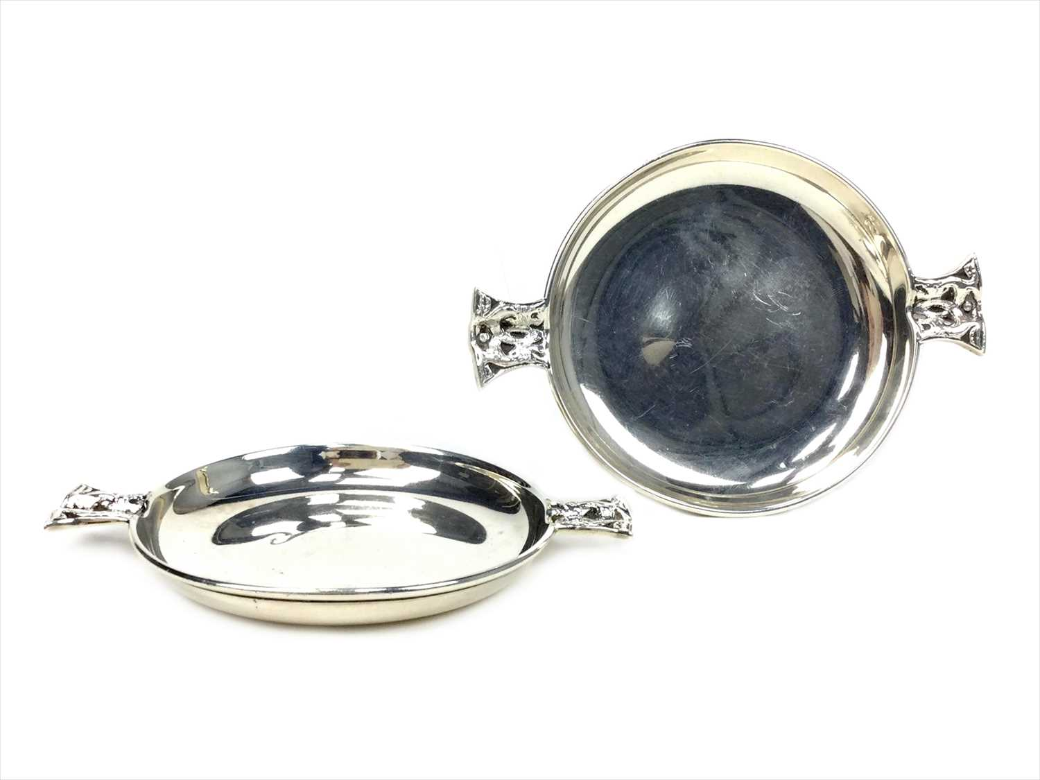 Lot 824-A PAIR OF SCOTTISH SILVER QUAICH FORM DISHES