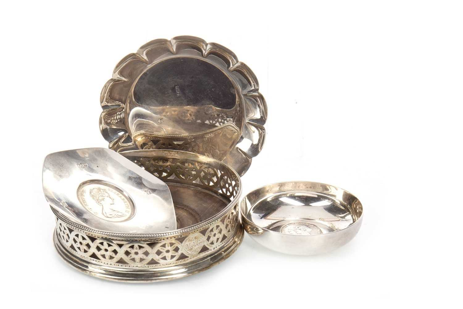 Lot 811-AN EARLY 20TH CENTURY SILVER CIRCULAR WINE SLIDE ALONG WITH THREE SILVER DISHES