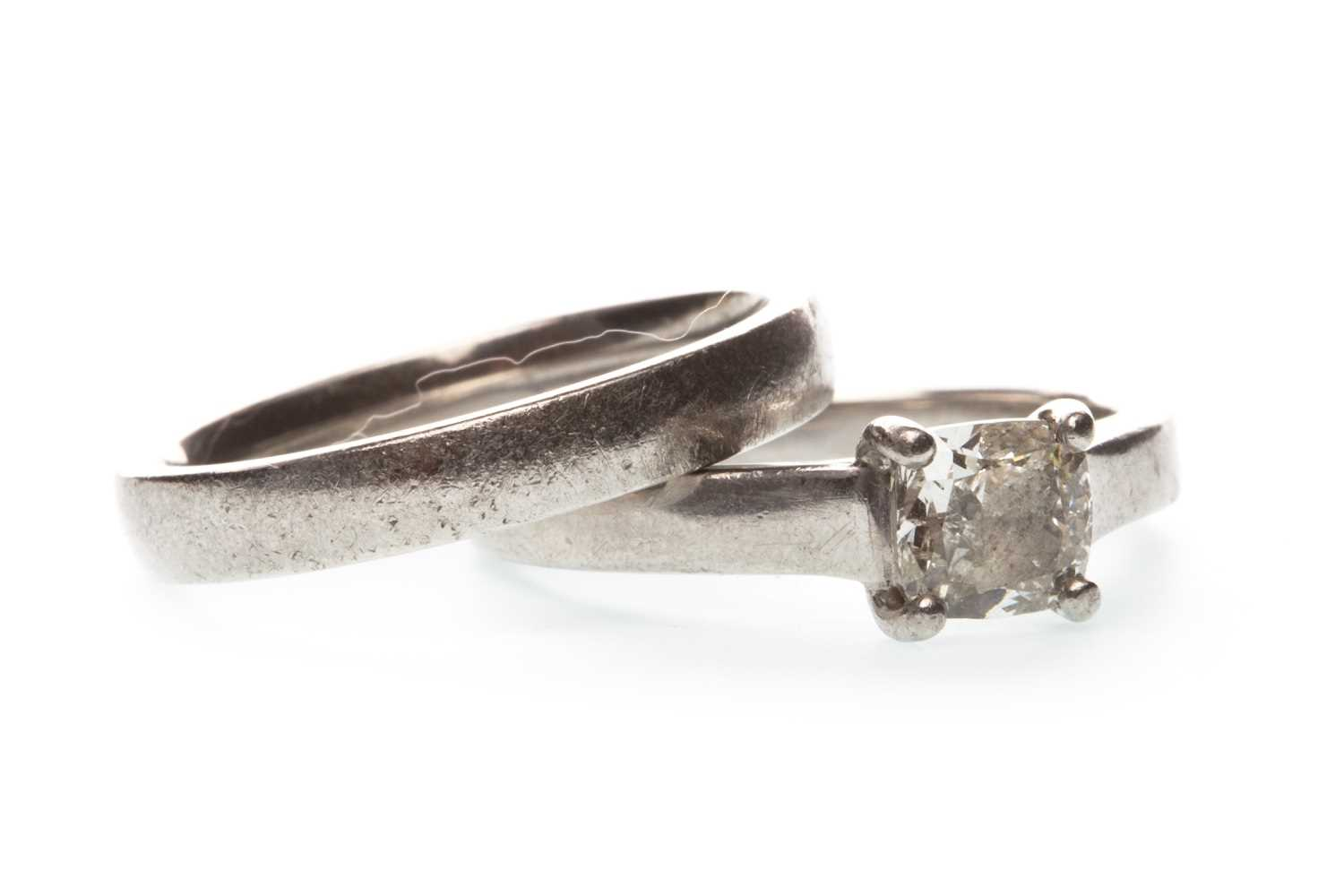 Lot 25-A DIAMOND SOLITAIRE RING WITH WEDDING RING