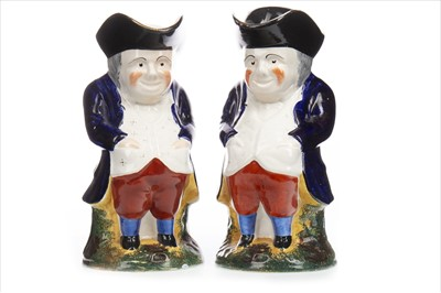 Lot 1225-A PAIR OF 19TH CENTURY STAFFORDSHIRE TOBY JUGS