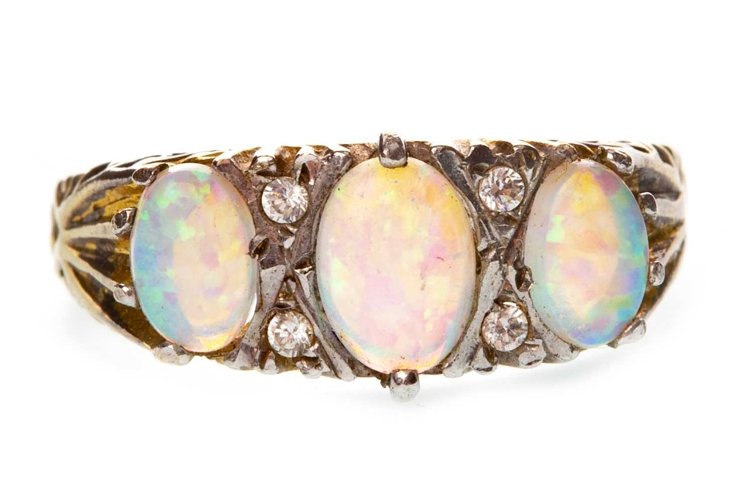 Lot 28-AN OPAL AND DIAMOND RING