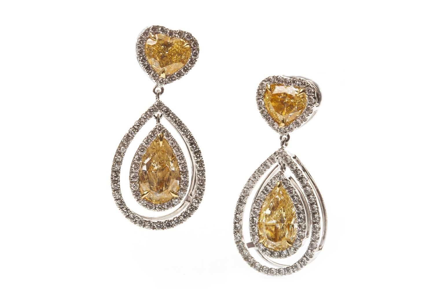 Lot 1-A CERTIFICATED PAIR OF YELLOW AND WHITE DIAMOND EARRINGS