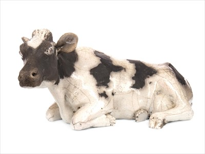 Lot 1244-A CONTEMPORARY EARTHENWARE SCULPTURE OF A COW