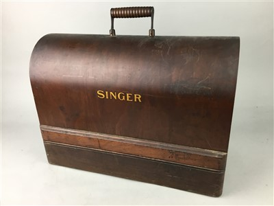 Lot 42-A SINGER SEWING MACHINE AND A CHARGER