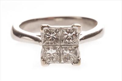 Lot 331-A DIAMOND FOUR STONE RING