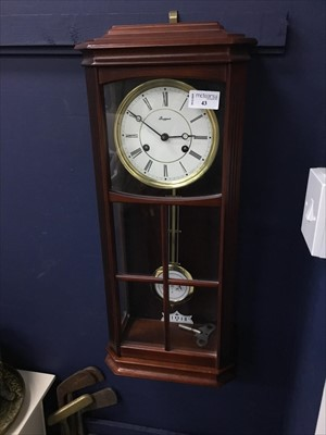 Lot 43-A STAINED WOOD RAPPORT WALL CLOCK