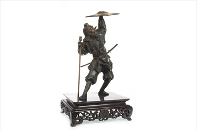 Lot 1133 - A CHINESE BRONZED METAL WARRIOR FIGURE