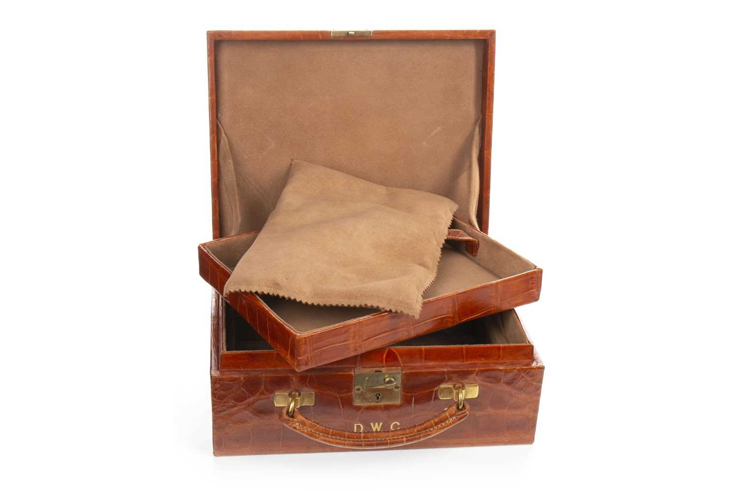 Lot 1646-AN EARLY 20TH CENTURY CROCODILE SKIN TRAVEL CASE