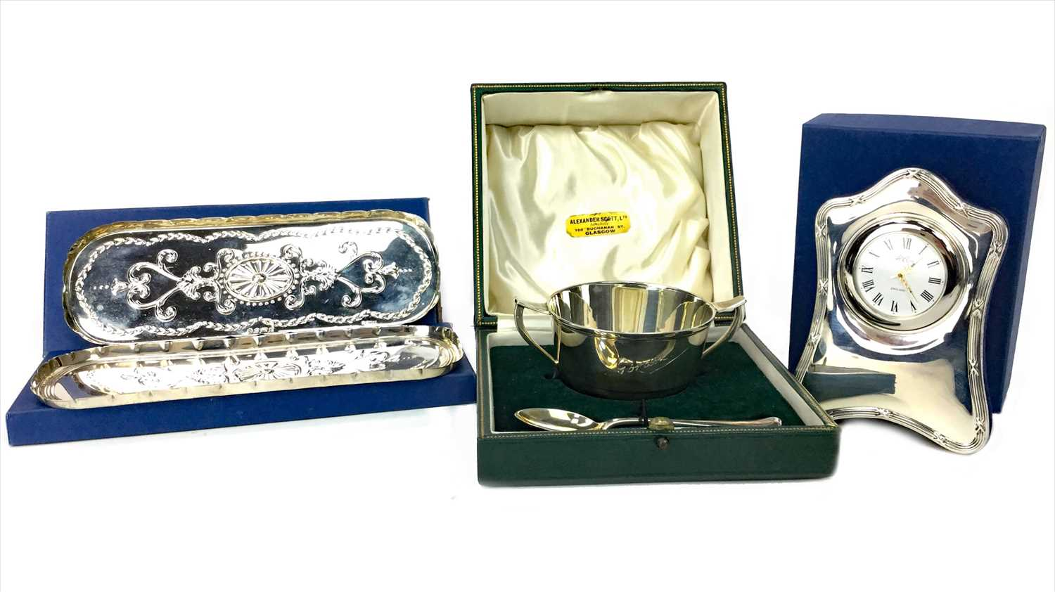 Lot 881 - A CONTEMPORARY SILVER FRAMED BEDSIDE TIMEPIECE