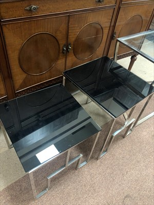Lot 563 - A NEST OF TWO MODERN GLASS TOPPED TABLES AND ANOTHER TABLE