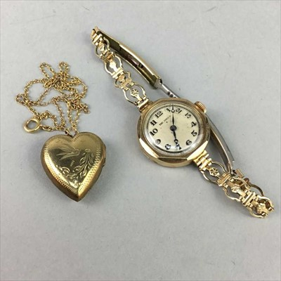 Lot 1-A NINE CARAT GOLD WATCH AND A LOCKET
