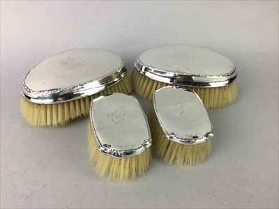 Lot 28-A LOT OF TWO PAIRS OF SILVER BACKED CLOTHES BRUSHES AND PLATED WARES