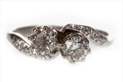 Lot 252-AN EARLY TWENTIETH CENTURY DIAMOND TWO STONE RING