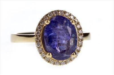 Lot 253-A TANZANITE AND DIAMOND RING