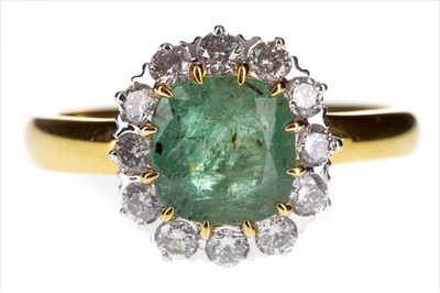 Lot 262-AN EMERALD AND DIAMOND RING