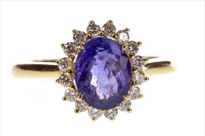 Lot 279-A TANZANITE AND DIAMOND CLUSTER RING
