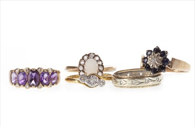 Lot 284-THREE DIAMOND SET RINGS AND TWO OTHERS