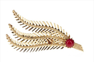 Lot 288-A RED GEM SET FERN BROOCH