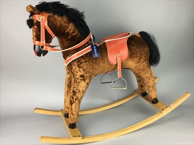 Lot 8-AN UPHOLSTERED ROCKING HORSE