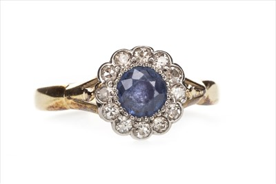 Lot 1304-A BLUE GEM AND DIAMOND RING
