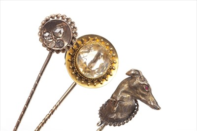 Lot 1321-THREE VICTORIAN STICK PINS