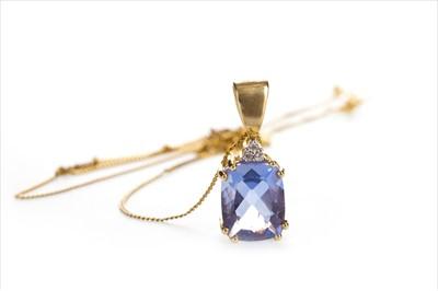 Lot 1312-A BLUE GEM AND DIAMOND PENDANT