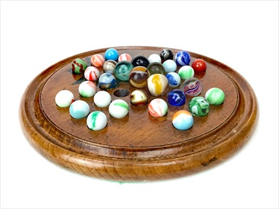 Lot 1762-A 19TH CENTURY SOLITAIRE BOARD AND MARBLES