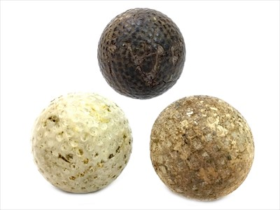 Lot 1728-AN LATE 19TH/EARLY 20TH CENTURY HASKELL TYPE GOLF BALL ALONG WITH TWO OTHERS