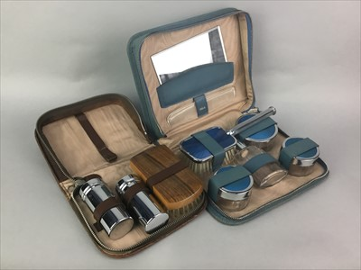 Lot 25-A LOT OF TWO TRAVEL VANITY SETS, PICNIC BASKET AND A TEA SERVICE
