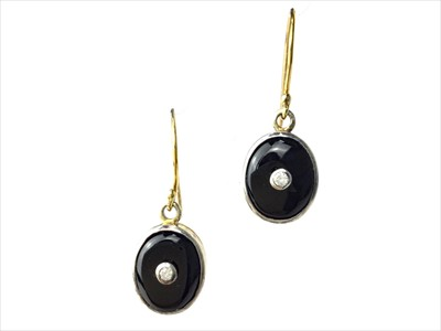 Lot 320-A PAIR OF ONYX AND DIAMOND EARRINGS
